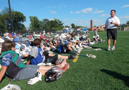 Episcopal Academy coach Chris Bates addresses the players at the season's first Duke's L.C.'s Ricky Whelan Clinic at Shipley