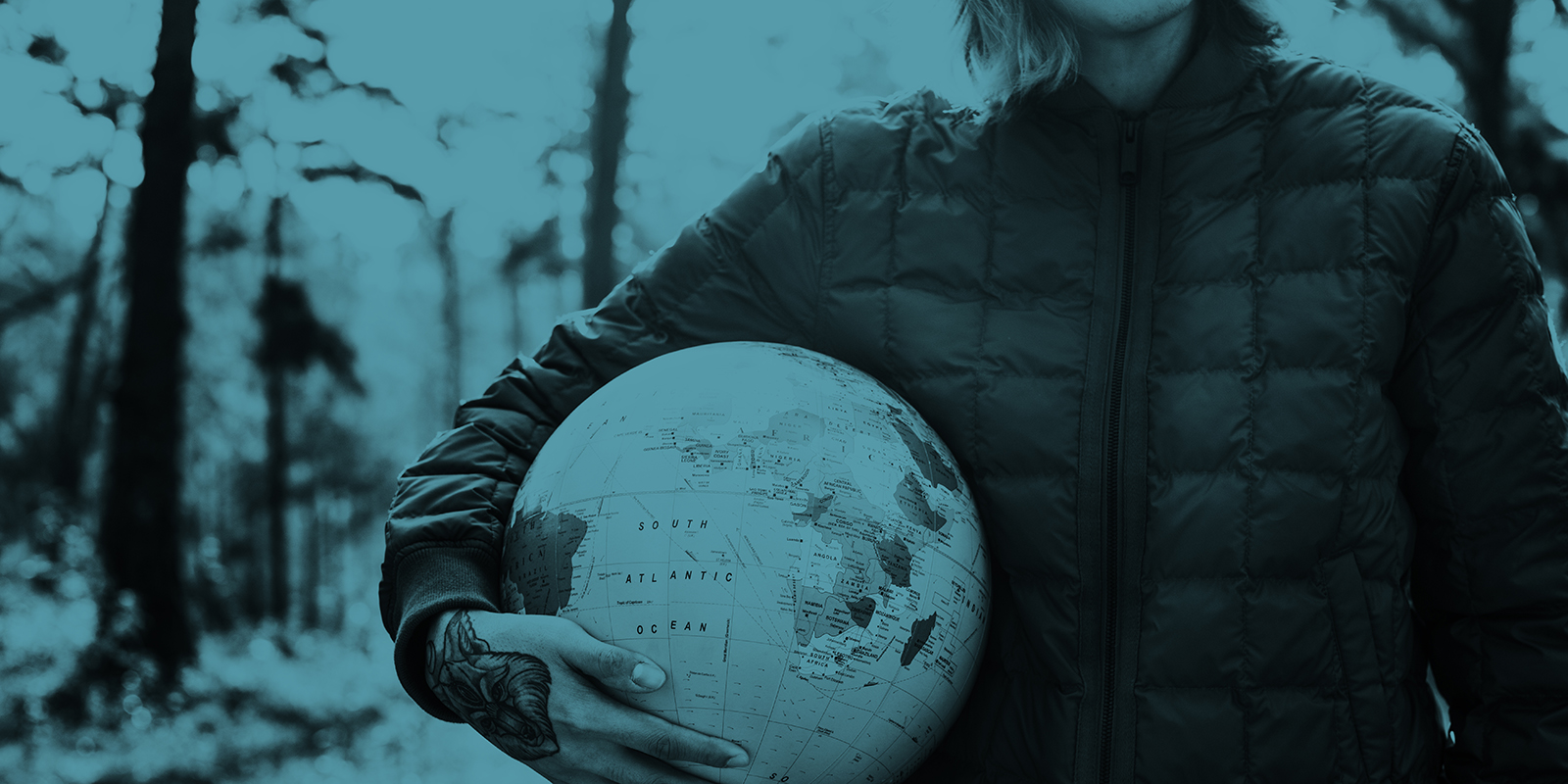 A picture of a man holding a world globe under his right arm with a tinted blue affect on the international PR agency page.