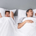 How to make someone stop snoring without waking them up?