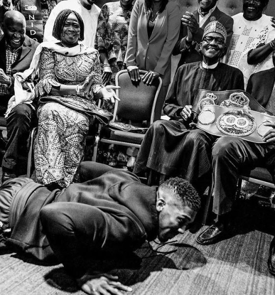 Anthony-Joshua-prostrates-to-President-Buhari-shortly-after-presenting-his-belts-during-a-meeting-with-Nigerians-in-United-Kingdom-today-t