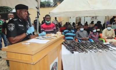 Police-Commissioner-Frank-Mba-with-the-39-suspects-paraded-on-Monday-636x424