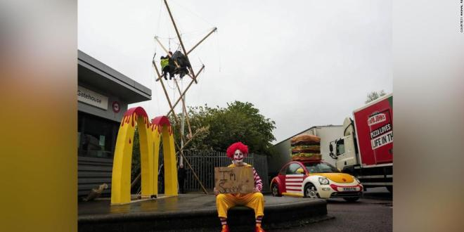 Animal and climate activists blockade McDonald's distribution centers across England