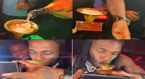 Burna Boy drinks from Grammy award plaque | The Nation Nigeria