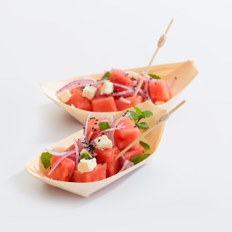 pine food boat with melon salad