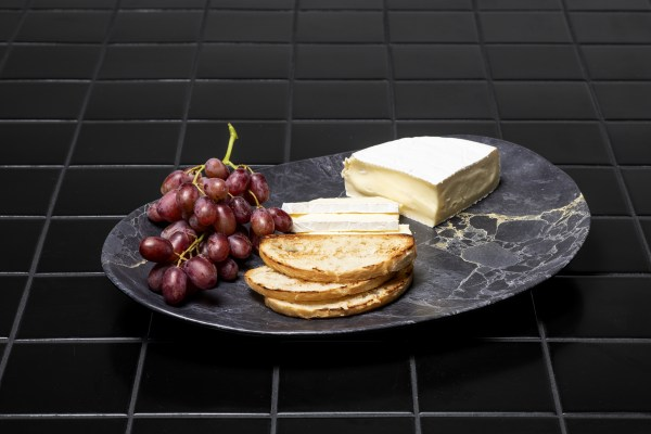 Resin Oval Platter with black granite design cheese and grapes on top