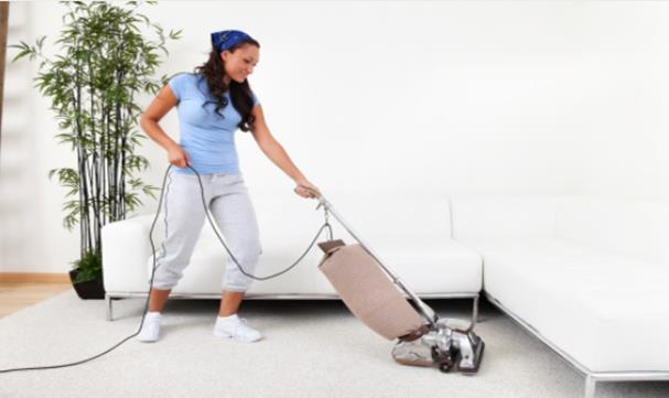 Lady Vacuuming Carpet