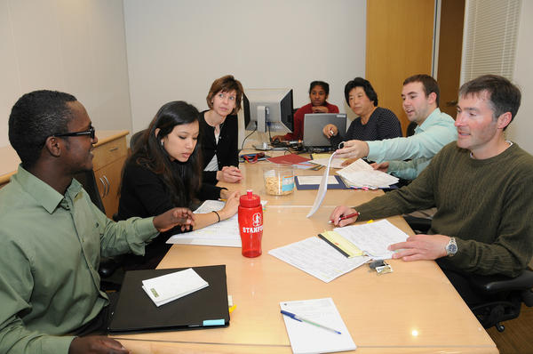 What does the admission committee use to evaluate international students?