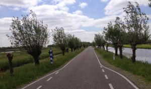 Cycling on Ziendeweg near Aarlanderveen Netherlands