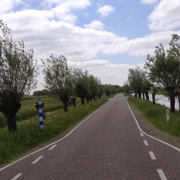 Cycling on Ziendeweg near Aarlanderveen Netherlands
