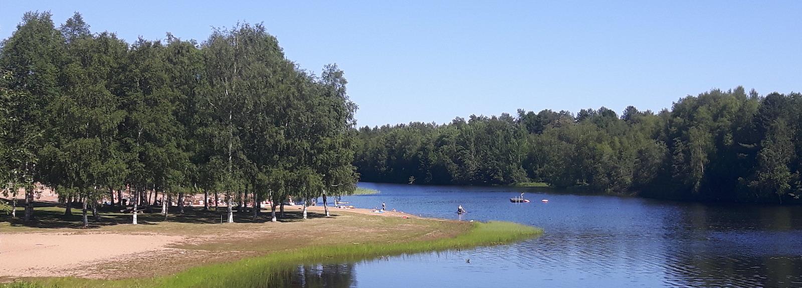 People Swimming on Warm day near Oulu Finland