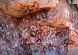 This is an image of a cave wall from Argentina. Although they appeared all over the world, to name a few: Spain, Indonesia, France, South America.
