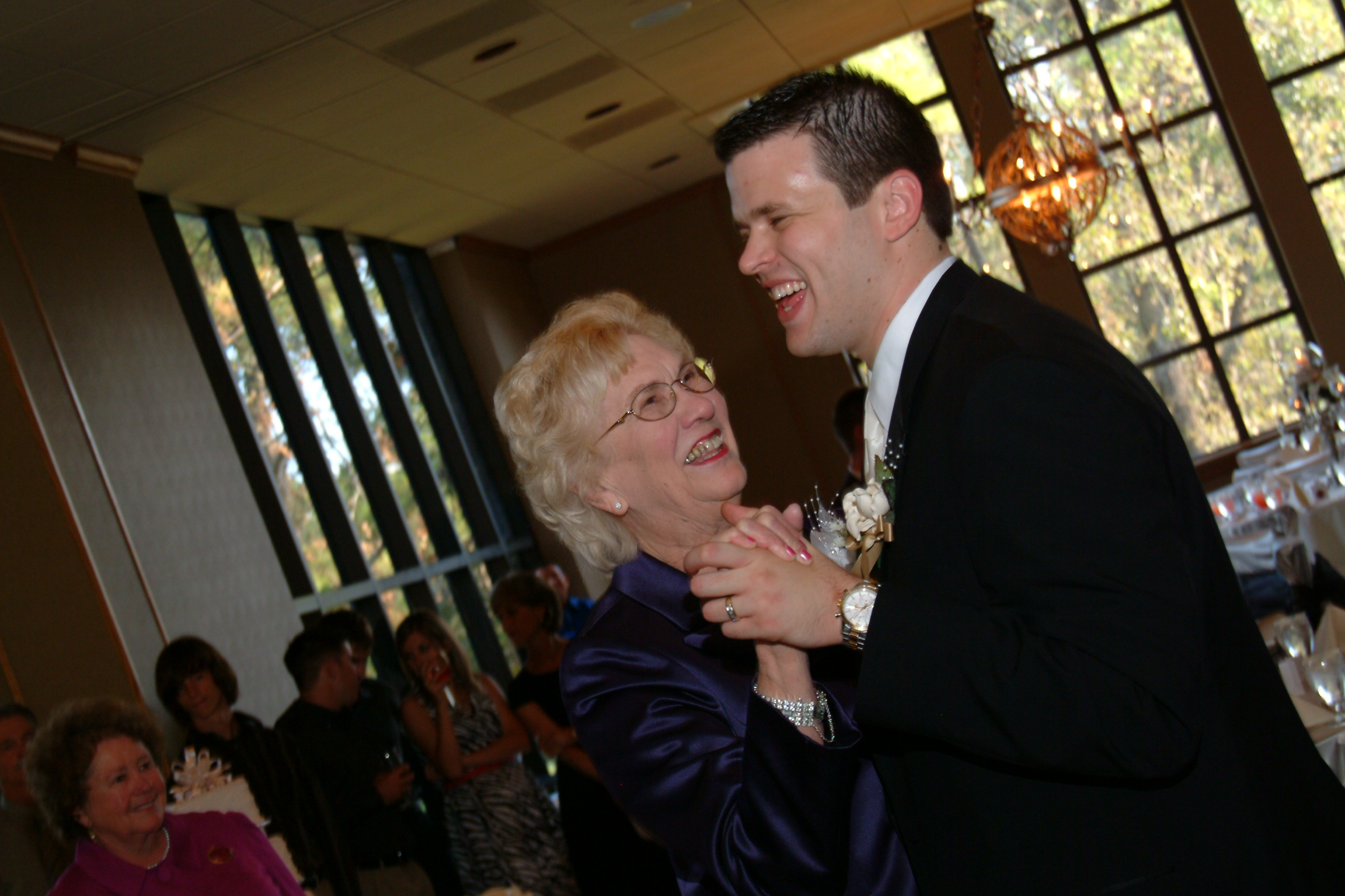 Dancing with her oldest grandson on his wedding day, October 2008.