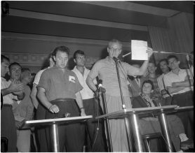 Bruno Zanini (left) and Charles Irvine (right) speaking at a Brandon Union Group meeting. Photo by Jack Judges. August 6, 1960. York University Libraries, Clara Thomas Archives and Special Collections, Toronto Telegram fonds, ASC52289.