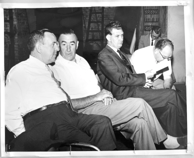 Gerry Gallagher seated on stage with other union leaders at Lansdowne Theatre. Photographer unknown. 1961. Archives of Ontario, Charles Irvine fonds.