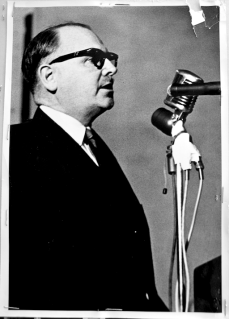 Dave Archer at microphone during Brandon Union Group strike meeting. Photographer unknown. June 1961. Archives of Ontario, Charles Irvine fonds.