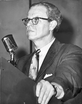 Charles Irvine at the microphone during Brandon Union Group strike meeting. Photographer unknown. 1961. Archives of Ontario, Charles Irvine fonds.