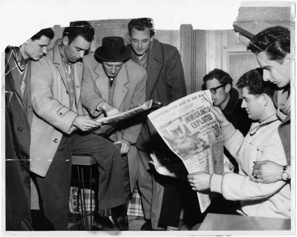 Italian immigrants reading the Toronto Telegram. Photo by Madison Sale. April 5, 1960. York University Libraries, Clara Thomas Archives and Special Collections, Toronto Telegram fonds, ASC52949