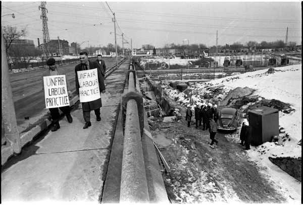 Norm Pike, Gerry Gallagher, and other inspecting a bridge building project on Gerrard Street. Photo by Bruce Reed. March 2, 1967. York University Libraries, Clara Thomas Archives and Special Collections, Toronto Telegram fonds, ASC52239.