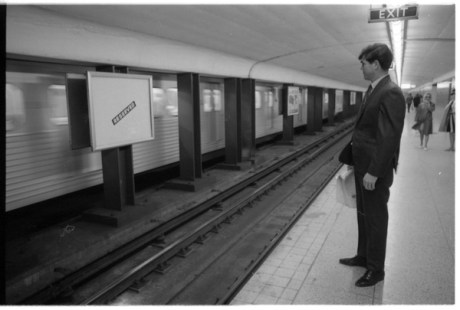 Norman Pike posing at a subway station for a Toronto Telegram photo shoot. Photo by Bruce Reed. September 21, 1970. York University Libraries, Clara Thomas Archives and Special Collections, Toronto Telegram fonds, ASC54797.