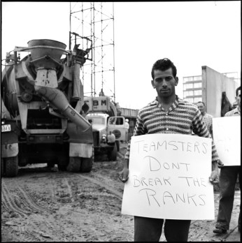 Brandon Union Group striker holding sign addressed to Teamsters Local 230 cement truck drivers. Photo by Richard Cole. August 3, 1960. York University Libraries, Clara Thomas Archives and Special Collections, Toronto Telegram fonds, ASC52282.