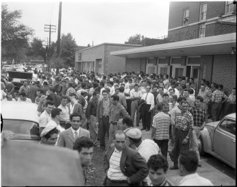 Workers gathered outside the Brandon Hall. Photo by Albert Van. August 03, 1960. York University Libraries, Clara Thomas Archives and Special Collections, Toronto Telegram fonds, ASC52286.