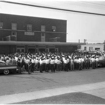 Workers outside 33 Brandon Avenue. Photo by Albert Van. August 12, 1960. York University Libraries, Clara Thomas Archives and Special Collections, Toronto Telegram fonds, ASC52296.