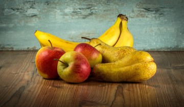 fruit arrangement of bananas, apples, and pears