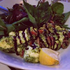 Fior-di-latte and cherry tomatoes with pistachio pesto, balsamic glaze, and field greens.