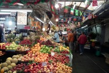 The local market packed with fruit and plants.