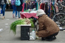 Local residents sell their goods on the sidewalks.