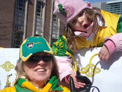 Irish Smiles: Sinead Curran, 4, and Catherine Curran of Hamilton are all smiles as they participate in the Toronto St. Patrick's Day Parade.