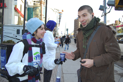 Maxwell House rep Katherine Scott gives free coffee to passer-by Mario Papadopoulos as part of the Brew Some Good Day campaign.