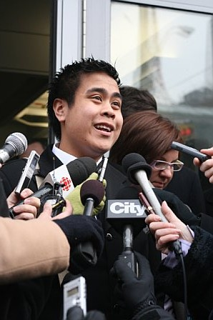 Chris Avenir speaks to the press after his hearing at Ryerson University.
