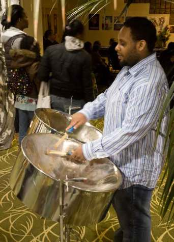 Steel pan drummer Taurean Clarke welcomed guests to the event with his Caribbean flavour of music. (Laura Ross/Toronto Observer)