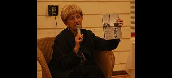 Renowned mystery writer Rosemary Aubert holds up a copy of her latest book, The Judge of Orphans, during a book discussion at Port Union Community and Recreation Centre's 25th anniversary celebration.