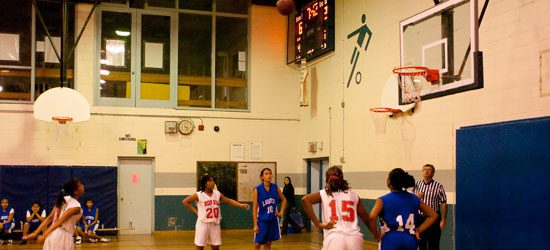 A West Hill Warrior takes a foul shot. The Warriors and Sir Wilfrid Laurier Blue Devils combined for 20 fouls in the first quarter.
