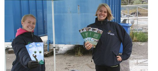 Sisters Heather and Angela Sande promote the Smart Meter for Toronto Hydro to folks dropping junk off last Saturday.