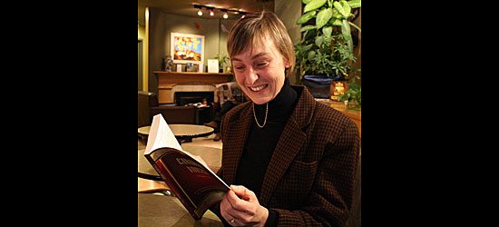 Betts looks over the table of contents in Canadian Voices: Vol. 1, containing the work of 58 emerging Canadian writers.