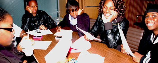 Students at homework club also use the time to socialize with friends.