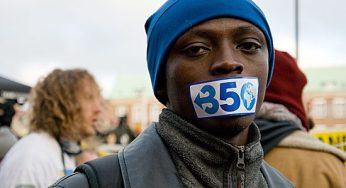 Kenyan protester makes a visual display of the silencing of poor countries in the climate talks and their plea for lower emissions with the 350.org campaign sticker covering his mouth.