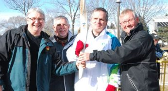 Olympic torchbearer Frank Peruzzi poses for a group photo.