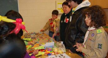 Highland Creek Scouts giving out prizes.