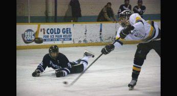 Lions player, Phil Janovski #5, gets a shot on net.