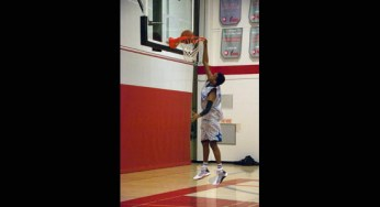 Sir Wilfrid Laurier Blue Devils forward, Cameron Mars #10, dunks the basketball during the pre-game warm-up.