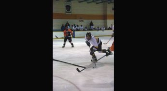 RH King Academy Lions player takes a shot on net, with defending Bendale Tiger's trying to block it.