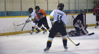 Lions forward, Tyler James fights for possession of the puck against Tiger defenseman, Phillip Dunaway #11. King academy's Connor Fischer #11, gets open for a pass.
