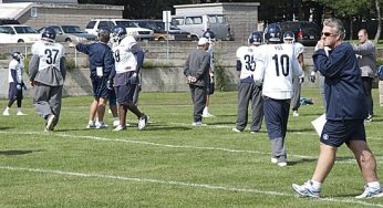 Argos head coach Jim Barker heads over to gather the team's offense.