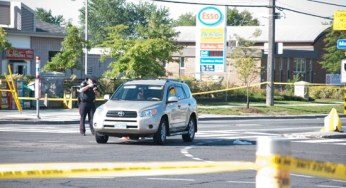 Police document damage to the SUV that reportedly struck a 23-year-old man in the intersection of Markham Road and Ellesmere Avenue Sept. 13.