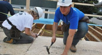 Habitat for Humanity Toronto CEO Neil Hetherington (right) joins volunteers in building 29 townhouses at 4572 Kingston Rd. on Sept. 24. The Habitat for Humanity Toronto ReTooling Blitz Build attracted more than 900 people from Sept. 20 to 25.
