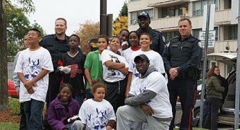 The bonds of friendship are strong between residents of 3181 Eglinton Ave. E. and members of the Toronto Anti-Violence Intervention Strategy (TAVIS). Kids from the building joined police to beautify the building's courtyard on Saturday.